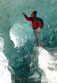 Science Diarist PJ Fleisher exploring an ice cave. Credit: PJ Fleisher.