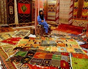 A shop in Fez is piled with carpets.